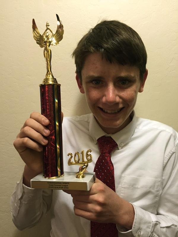 Freshman Dominic Thibault holds his trophy after a weekend of Congressional debate. Thibault, along with senior Ariya Momeny, are the first Paly students to ever qualify at the state-level for Congressional debate. Photo: Colin Thibault.