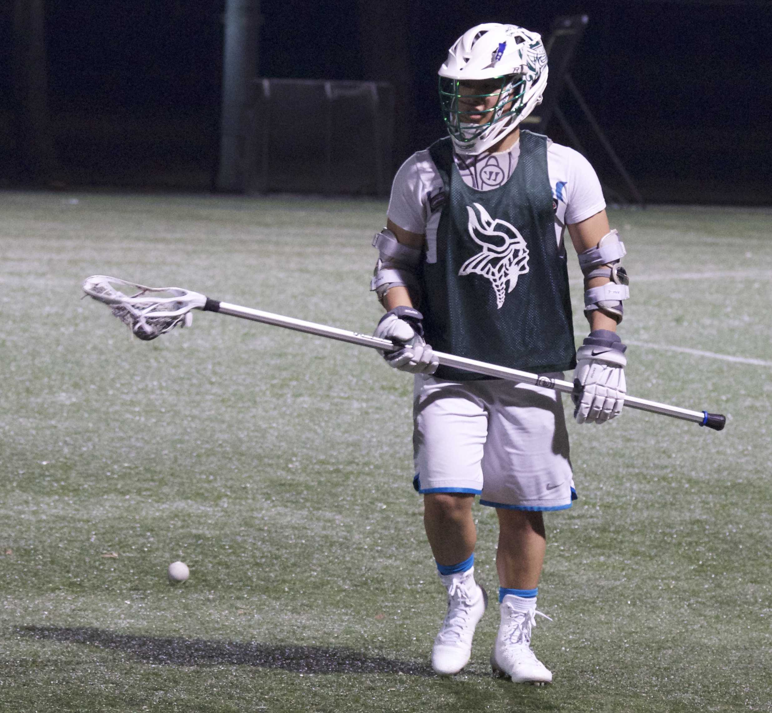 Long stick defender Trevor Woon rotates positions in a drill during preseason practice. The season starts on Mar. 4. Photo by Sam Lee.