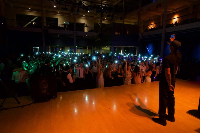 Palo Alto High School students wave their phones in the air at Prom 2016. Photo by Cooper Lou.