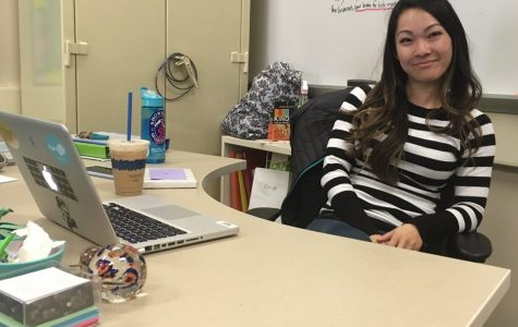 English and Humanities teacher Mimi Park sits at her desk with an iced latte while discussing her   career change.