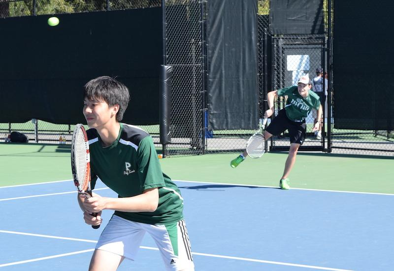 Junior Henry Badger serves while junior Jerry Hong prepares for the return. Badger and Hong lost their match in two close sets.