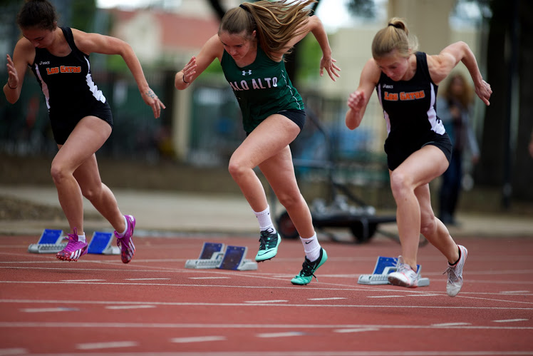 Paly Senior Kelly Branson competes in the 100 meters. Both the boys and the girls team fell to Los Gatos last Tuesday at Home.