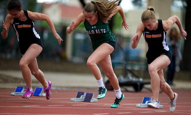 Palo Alto High School senior Kelly Branson competes in the 100-meter race at the Paly vs. Los Gatos track and field meet. Both the boys and the girls team fell to the Wildcats on Tuesday at home. Photo by Cooper Lou.