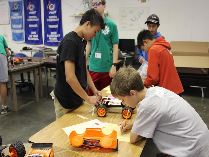 A camper at the 2015 Robotics Summer Camp working on his remote control car for the