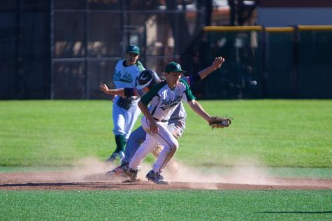 Junior shortstop Ethan Stern looks to turn a double play during a regular season game against Los Gatos. The Vikings defeated the Wildcats in the final game of a three game series to secure the SCVAL title. Photo by Cooper Lou.