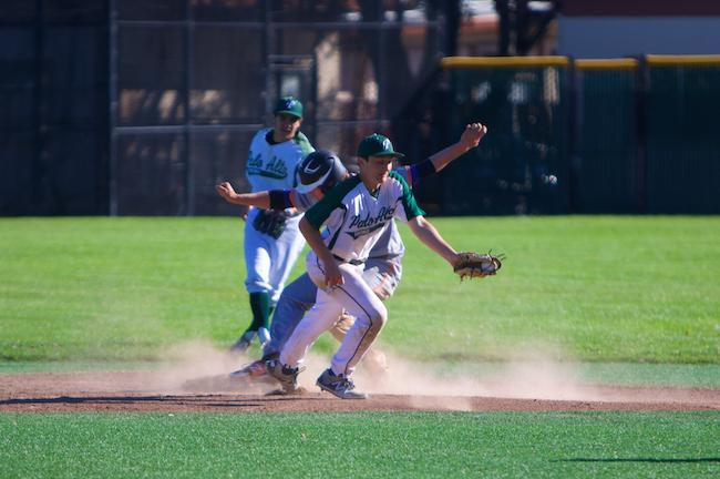 Junior shortstop Ethan Stern looks to turn a double play during a regular season game against Los Gatos during a home league match. The Vikings defeated the Wildcats in the final game of a three-game series to secure the SCVAL title. Photo by Cooper Lou.