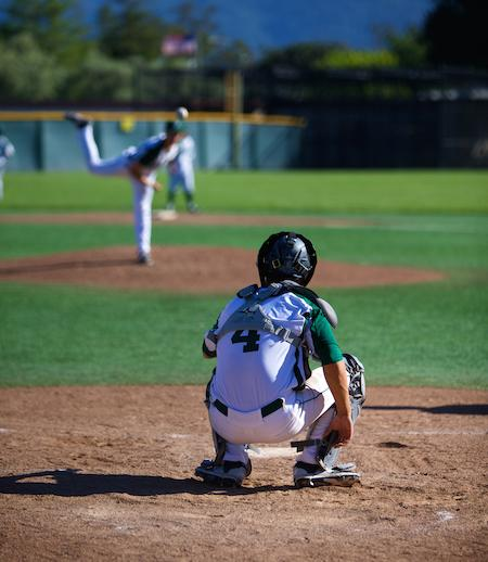 Senior pitcher Alec Olmstead warms up with Senior catcher Lawrence Han before a regular season game against Los Gatos High School. Han has been a dependable plate general for the Vikings all season. Photo by Cooper Lou.
