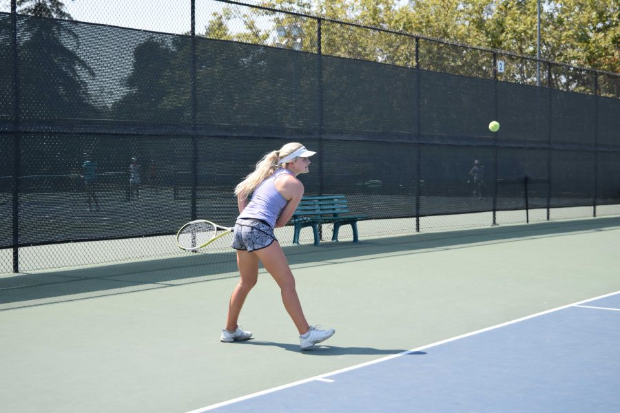Captain Meredith Cummings prepares for a forehand swing during practice