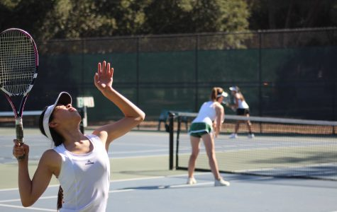 Senior Alice Zhao prepares for a serve in a doubles match Thursday. The pair helped boost the team to a dominant 5-2 win. Photo by Sid Sharma.