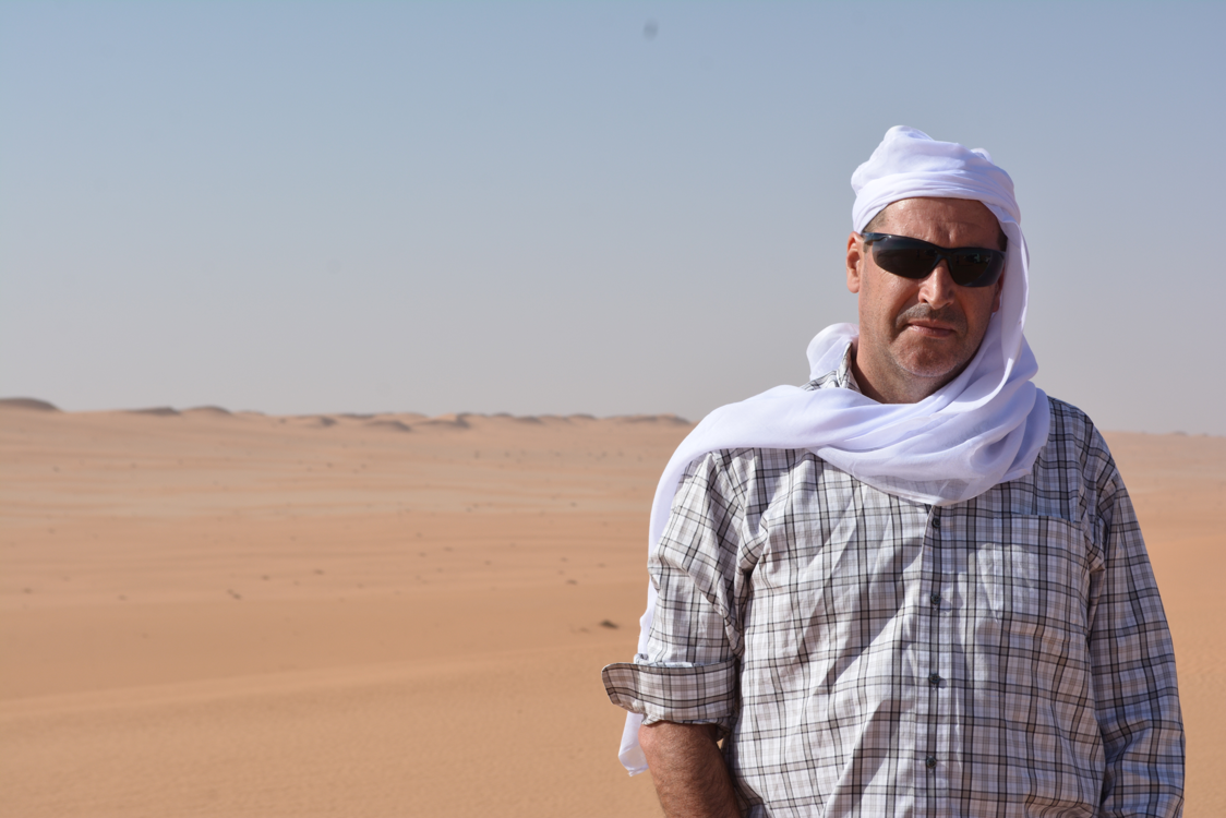 Jose Ezcurra stands with his back against the Saudi Arabian desert. Ezcurra enjoys exploring new areas and says nothing beats seeing something for the first time. Photo: Jose Ezcurra.