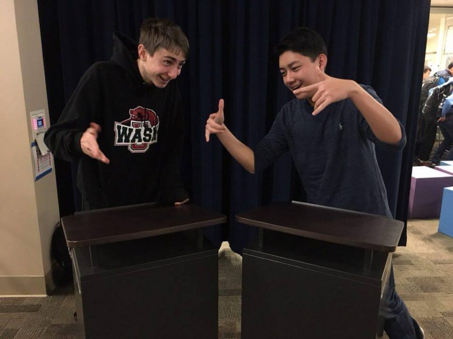 Senior debater Colin Fee (left) and junior debater Barry He (right) passionately discuss their debate successes and excitement for their bright futures.