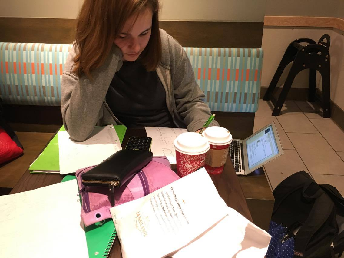Junior Chloe Iglehart studies diligently at a local Starbucks. Photo by Maya Reuven.