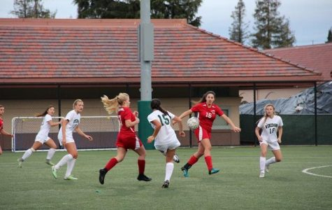Senior captain Natalie Maloney attempts to make a pass to freshman Sophie Vogol. Maloney would go on to score four goals for Paly in their 11-0 rout of El Camino High School. Photo: Sam Lee