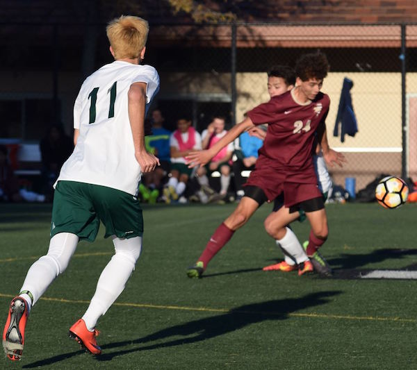Senior center midfielder Charles Stoksik sprints to intercept a lofty pass during a preseason matchup against Menlo-Atherton on Dec. 6 at Paly.