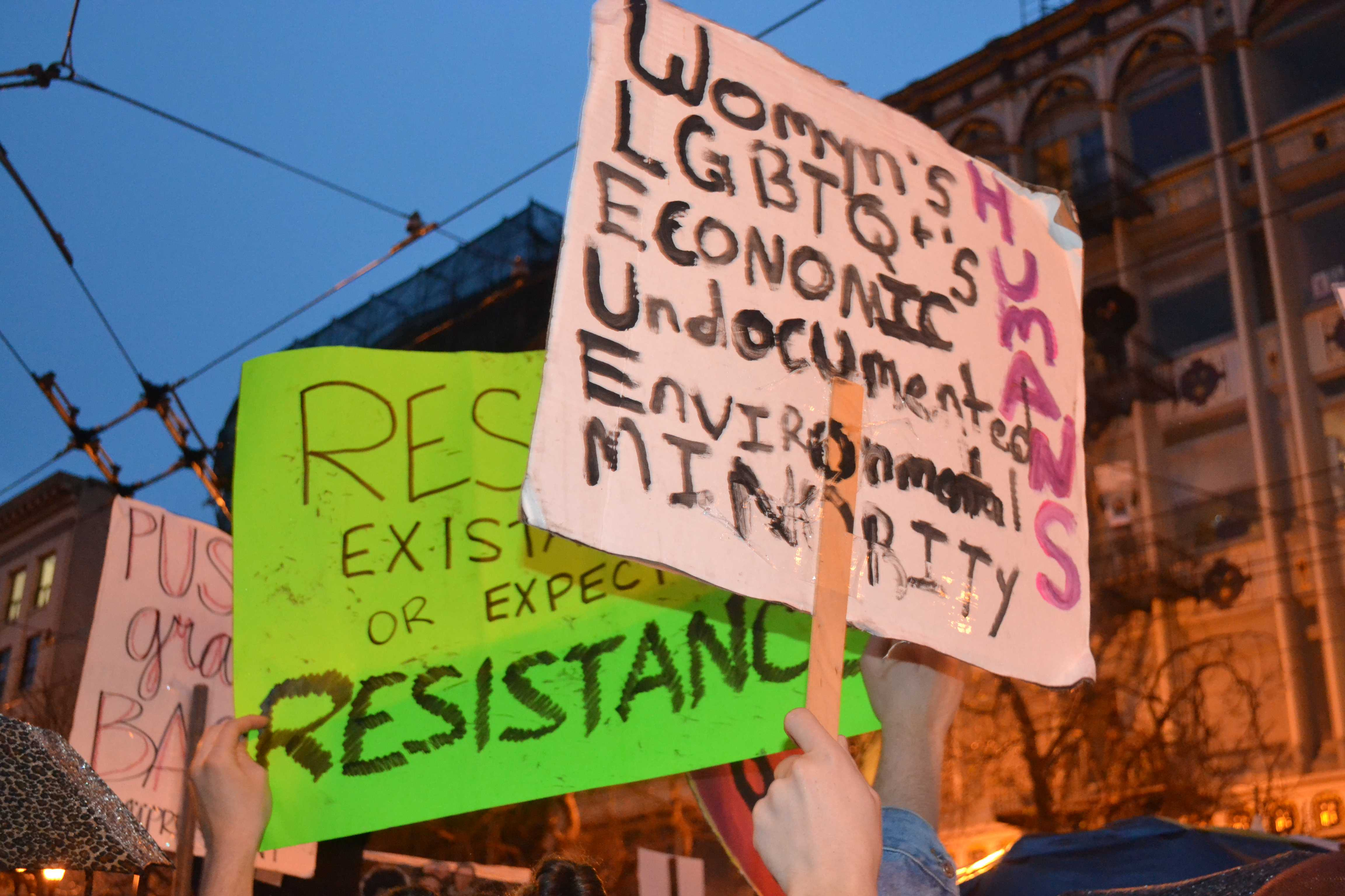 "A neon green sign reads ""respect my existence or expect resistance."" Photo: Emilia Diaz-Magaloni"