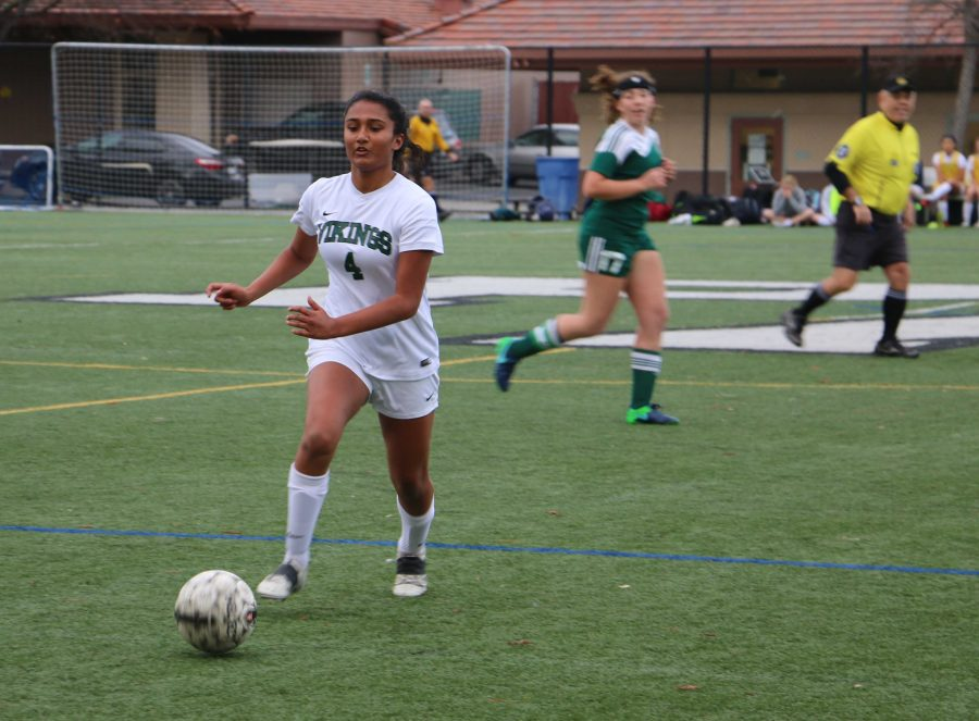 Sophomore Leena Srinivasan passes the ball in the second half. Srinivasan was dominant in the midfield tracking down loose balls and blocking the passing lanes.  Photo by Ethan Kao.