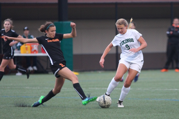 Freshman Chloe Japić narrowly avoids a Los Gatos player's attack. Photo: Emma van der Veen.