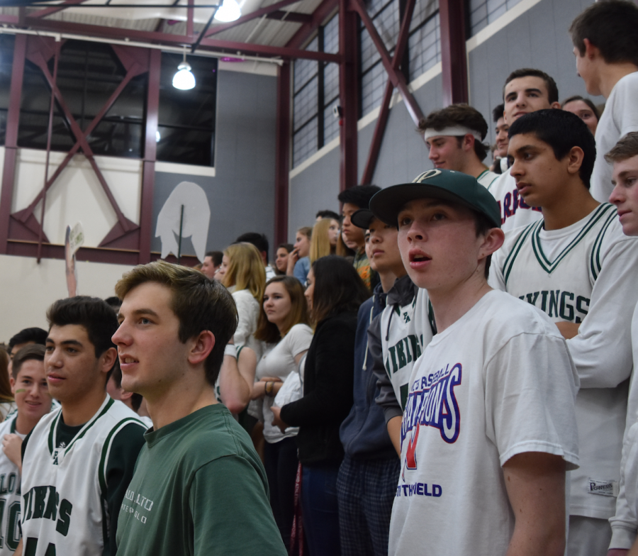Senior Michael Champagne and the rest of the Paly student section file in near the end of the girls basketball game. The Vikings would go onto win the game, 61-45. Photo by Rachel Code