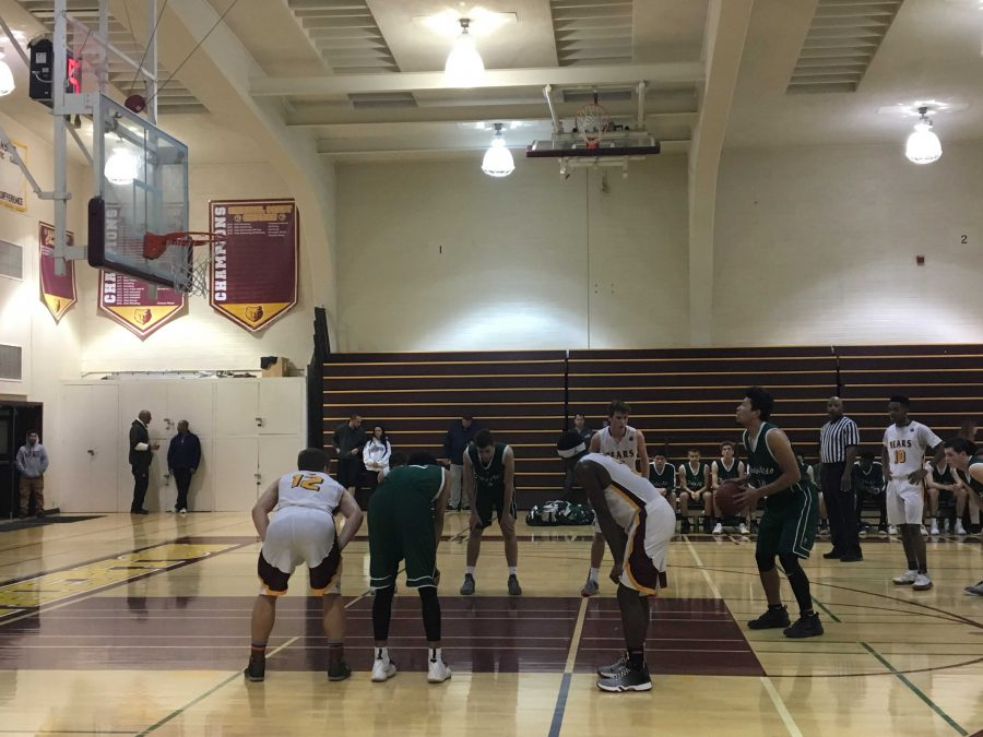 Junior Bryant Jefferson lines up a free throw against Menlo-Atherton. Photo by Benner Mullin