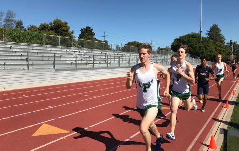 Junior Sam Craig leads the varsity boys' 1600-meter run at the Tuesday afternoon meet versus Milpitas. The boys' varsity team dominated Milpitas, while the other divisions saw closer matchups.