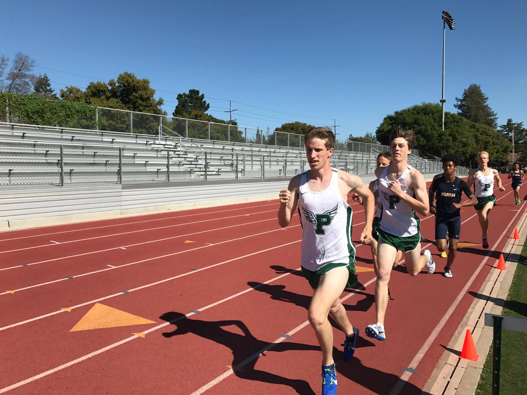 "Junior Sam Craig leads the varsity boys' 1600-meter run at the Tuesday afternoon meet versus Milpitas. The boys' varsity team dominated Milpitas, while the other divisions saw closer matchups. ""I thought the team did very well overall,"" junior sprinter Daniel Nemeth said. ""The underclassmen have really stepped up."" Photo: Jevan Yu."