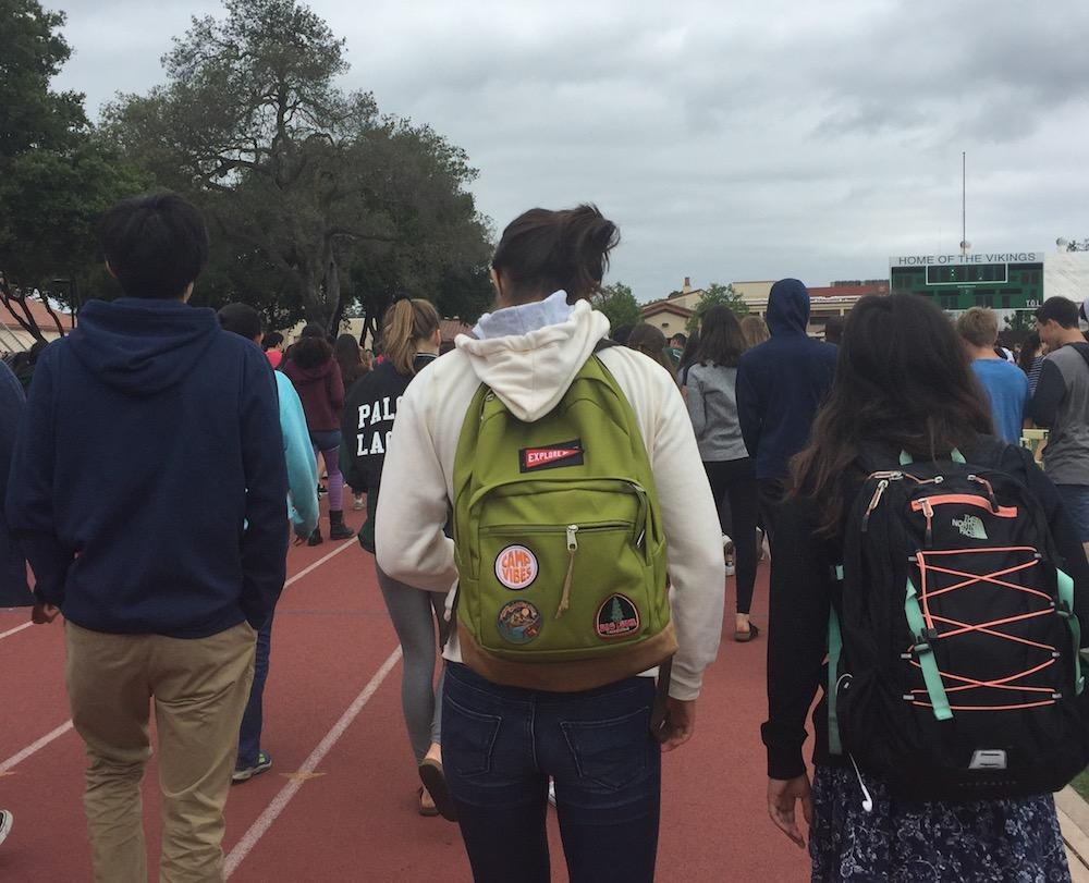 Palo Alto High School students exit the Viking Stadium after being dismissed from the fire alarm response gathering during fourth period today. Photo: Emma van der Veen.