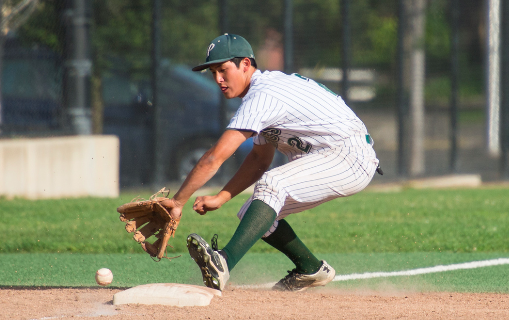 Junior third baseman Niko Lillios picks up the line drive. Photo by: David Hickey