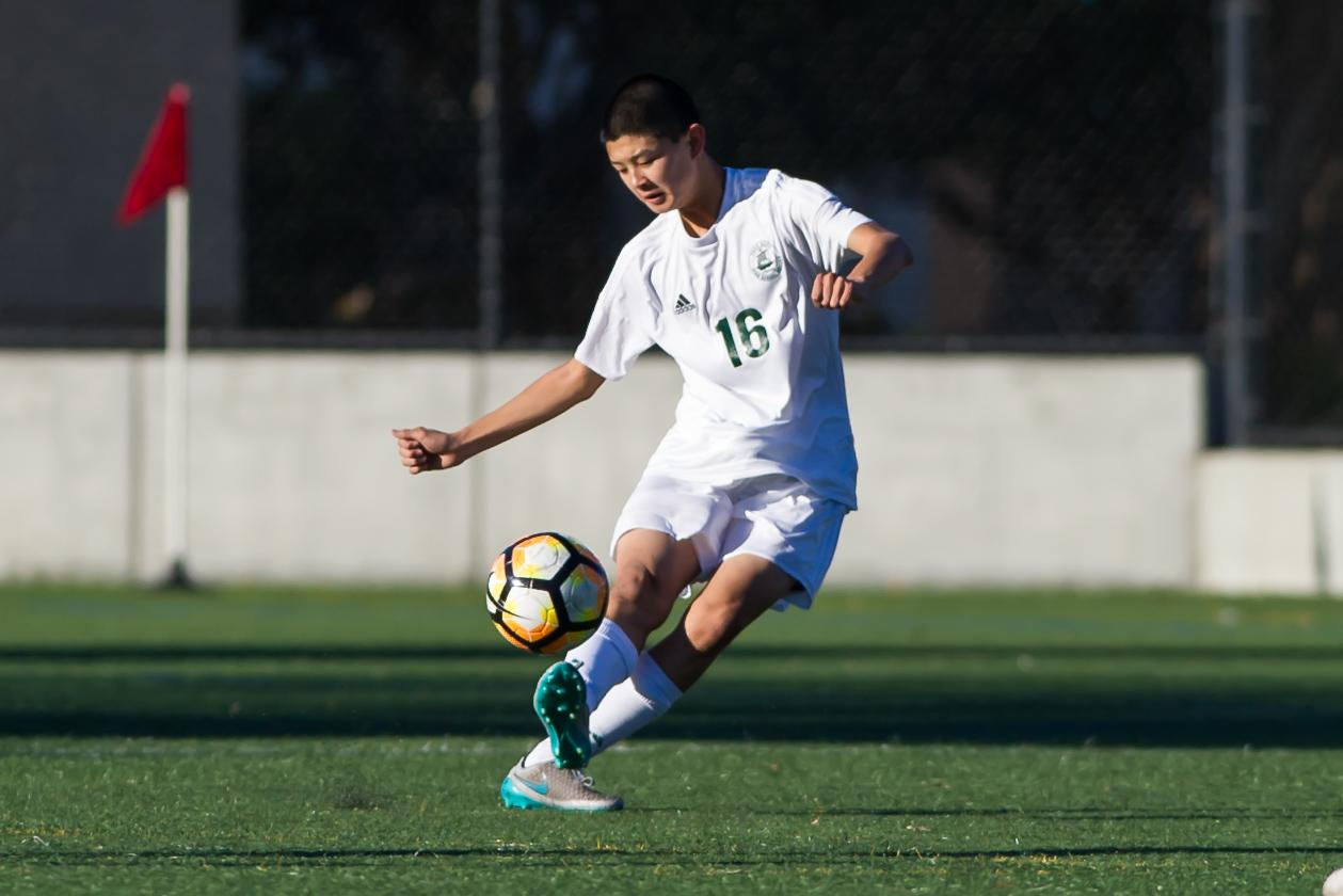 Junior Nathan Seto clears the ball out of his team's half against Monte Vista on January 24, 2017. Seto started at left back for varsity his sophomore year. Despite making the JV team his freshman year, he still thinks that there should be a freshmen team. Photo: David Hickey