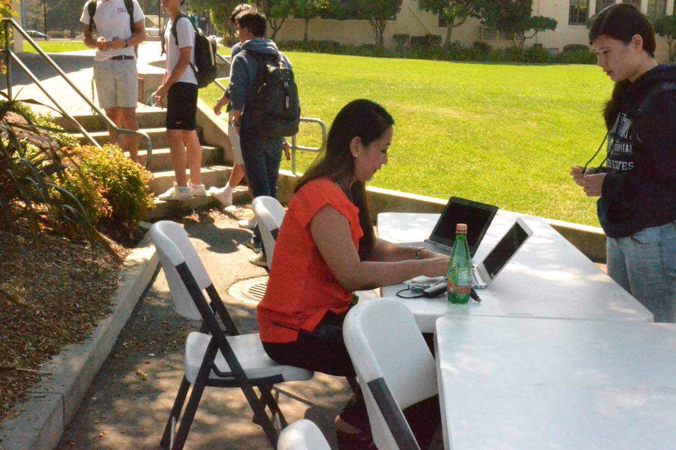 The new Assistant Principal of Teaching and Learning, Janice Chen, checks in students during Flex. Chen said that Paly administrators are doing what they can to make stipends more equitable among the coaches of different sports. Photo: Nisha McNealis.
