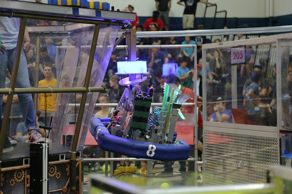 "A robot climbs up a rope into an ""airship"", securing extra points for its alliance. According to Team 8's Build Captain Shota Yamamoto, this task was one of three challenges robots had to complete during each match at Chezy Champs."