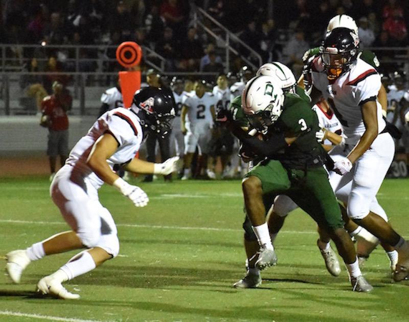 Sophomore wide receiver Jamir Shepard pushes for his second touchdown in Vikings' Friday night defeat against Aragon High School. Shepard stepped up in Friday's game, helping make up for the absence of star senior runnings backs Paul Jackson III and Stone Latu. Photo: Noah Yuen