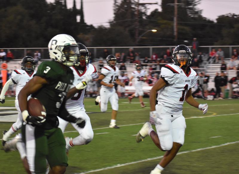 Sophomore wide receiver Jamir Shepard moves up the field against Aragon High School. Photo: Noah Yuen