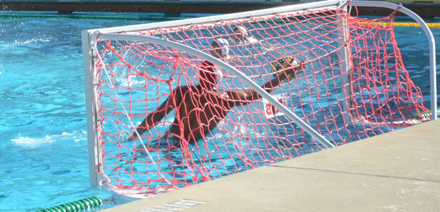 A Lynbrook High School goalie blocks a fourth-quarter shot during a game Tuesday afternoon at Palo Alto High School. Lynbrook went on to lose the game, 11-8. Photo: Soumya Jhaveri