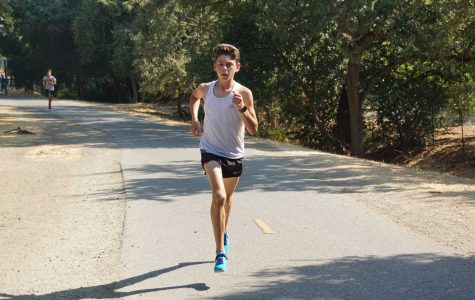 Freshman runner Alex Selwyn speeds to the finish line in the Gunn Alumni meet at Bol Park on August 31, 2017. Selwyn won the boys freshmen 2.18 mile race with a time of 12:29.