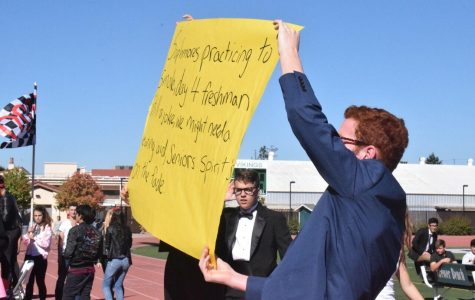 During Spirit Week Day Four, sophomore Benjamin Rapperport holds up sign with cheer on it. Sophomores in the stands chant for their participants in the games. Photo by: Nisha Mcnealis