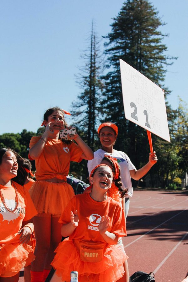 Freshmen+cheer+on+their+classmates.+Photo+Credit%3A+Angelina+Wang
