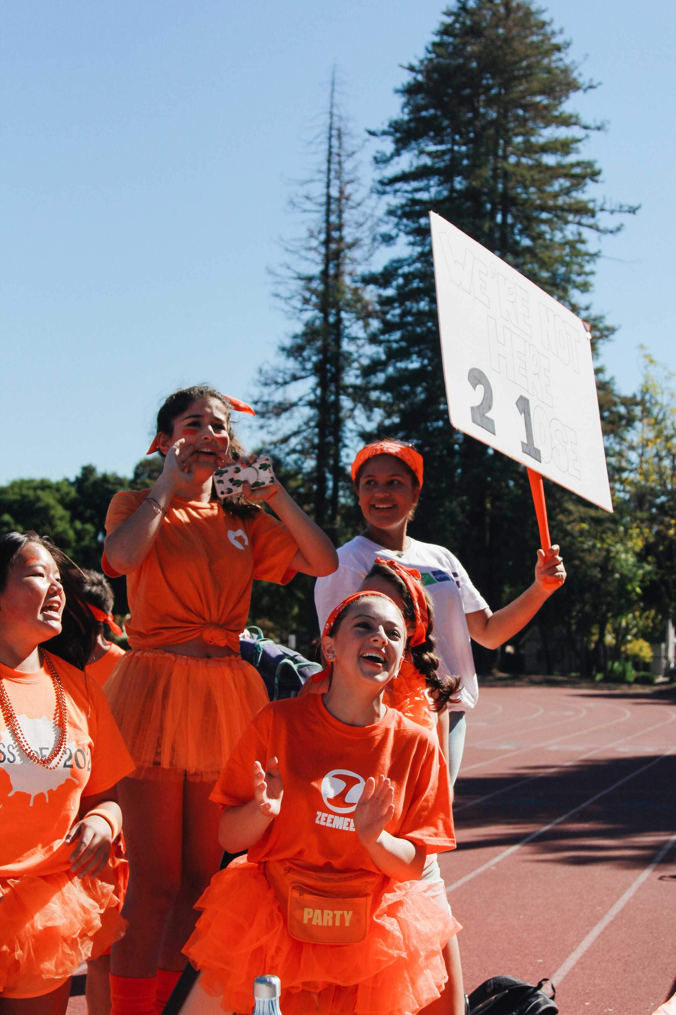 Freshmen cheer on their classmates. Photo Credit: Angelina Wang