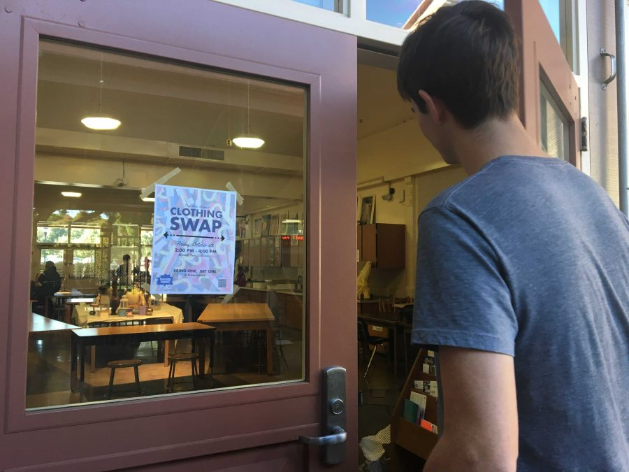 A student walks into the painting and drawing classroom,  admiring the Teen Arts Council clothing swap flier. Photo: Leila Chabane