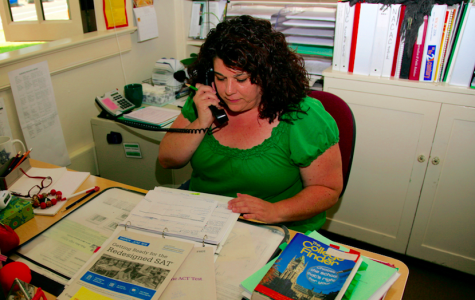 Palo Alto High School College Advisor Sandra Cernobori works at her desk in the College and Career center, answering questions regarding standardized testing.