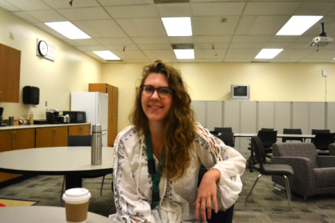 English teacher Lizzie DeKraai poses with her coffee in the English offices. Photo by Leila Chabane.