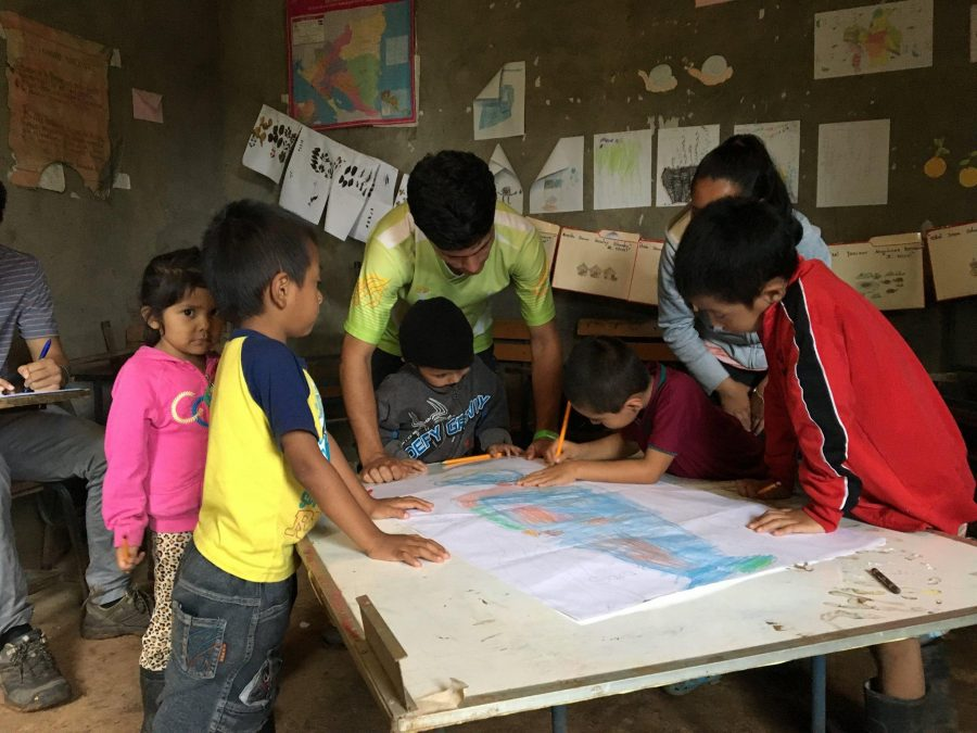 Amigos volunteer Will Wagman takes pictures of other Amigos volunteers working with local kids in Nicaragua. The Amigos program allowed Wagman  to work with many kids and volunteers he never thought he would work with.
