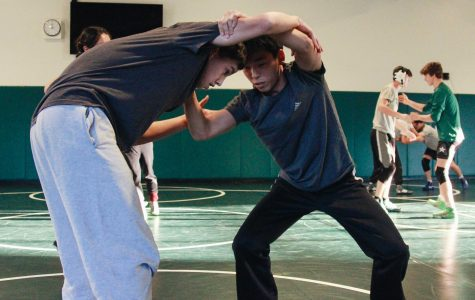 Senior Cooper Kim and Who Knows practice in the new wrestling room of the Peery Family Center.