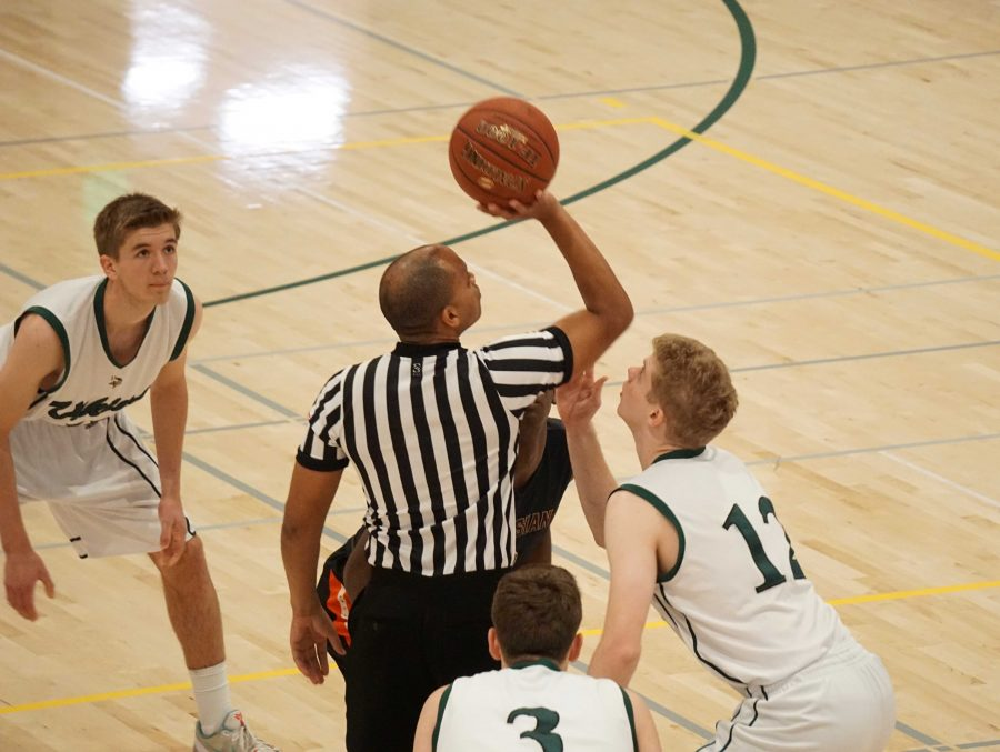 Senior forward William Schlemmer waits for the jump ball to start Paly's game against Salesian on Saturday at the Peery Family Center. Schlemmer believes the Vikings need to come out stronger in the third quarter of games, as Paly lost a an eight point lead in the third quarter.