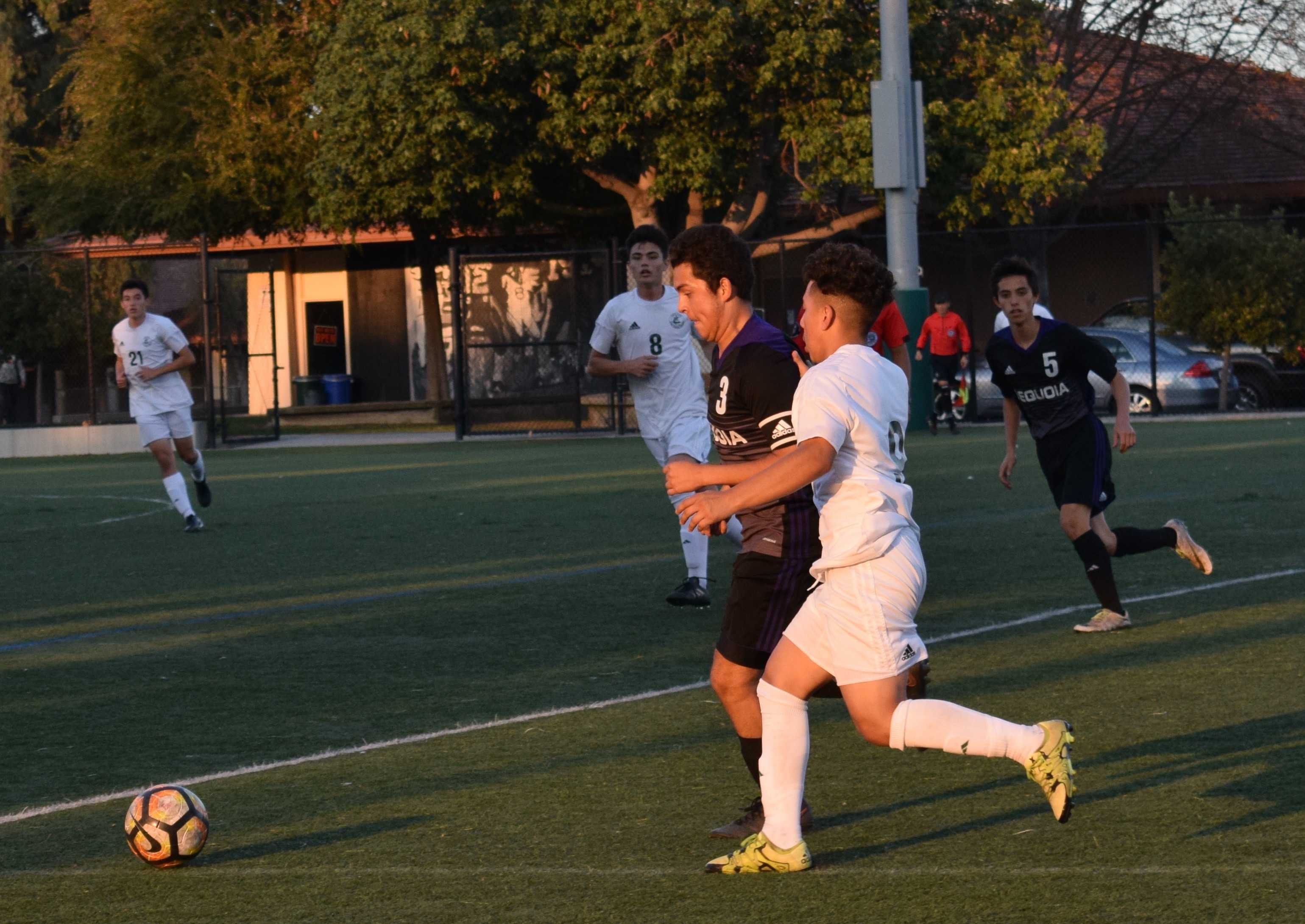 "Junior Marco Tan dribbles past a defender and goes on to score the only goal of the game against Sequoia High School. ""This was my first goal of the season,"" Tan said. ""I had a few last year and it took four or five games to get back this year."""