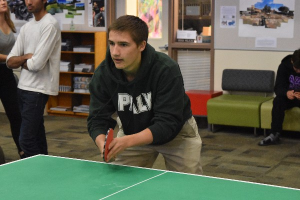 Senior Will Schmutz prepares to face off against his opponent during the first round of the tournament on Monday.  Photo: Benjamin Huang