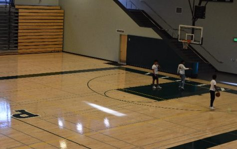 Sophomores Junacio Henley and Jamir Shepard,   Junior Dwayne Trahan shoot  hoops in the Peery Center's Large Gym. The Associated Student Body will hold the Winter Rally basketball  game between students and staff in the Large Gym on Jan. 23.