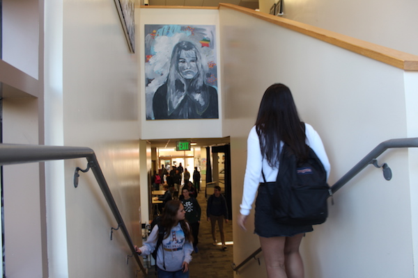 "Paly students pass under one of Golden-Globe winning Paly alumnus James Franco's paintings displayed above a stairwell in the Media Arts Center. After five separate allegations of sexual harassment and misconduct arose against Franco last week, students and parents are concerned whether his artwork has a place on campus. ""I don't want to overreact and I want to be very thoughtful,"" said Principal Kim Diorio. ""At the end of the day we need to make sure our school is safe for all students."" Photo: Sophia Muys."