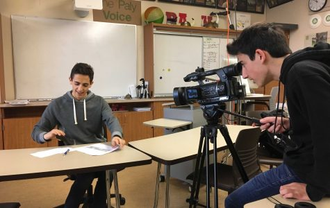 Junior David Foster, a coordinator for the community outreach subcommittee of the Innovative Schedule Committee, speaks to several members of Palo Alto High School's media program as the committee continues to deliberate.