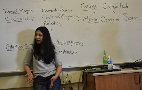 "Sarah Tariq, a research for the development of self-driving cars at Zoox, explains about her career journey to Palo Alto High School students on Day 3 of Career month. Tariq, who initially thought that she would pursue a career in medicine during her high school education, transitioned into the recently-emerging machine learning field. ""Everyone's career path is going to be different and there doesn't need to be clarity on what you are doing 10 years from now,"" Tariq said. ""What's important is finding what motivates you."" Photo: Eric Yap"