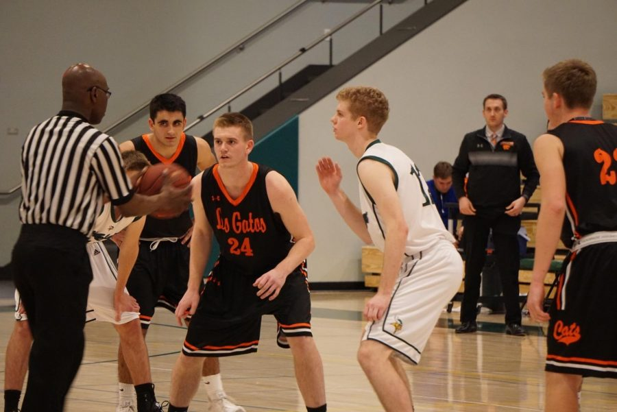 Senior forward Wiliam Schlemmer prepares for a jump ball against Los Gatos senior Dylan Belquist, Friday at the Peery Family Center. Up one at halftime, Paly stormed out of the gate in the second half, fueled by senior guard Will Schmutz's defensive intensity.